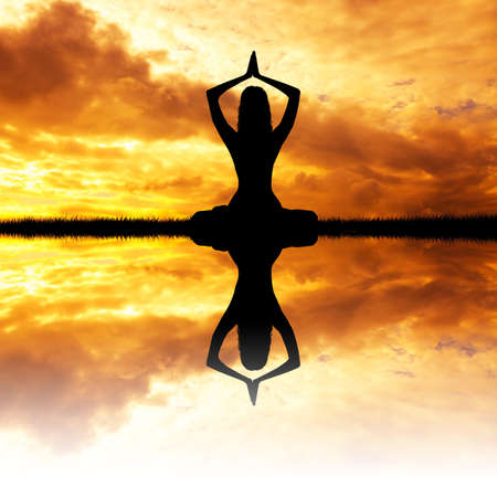 meditator: yoga at sunset