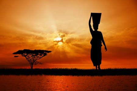 mara: African woman at sunset