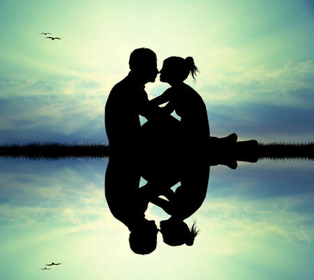 couple kissing on river photo