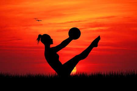 pilates ball: Pilates at sunset