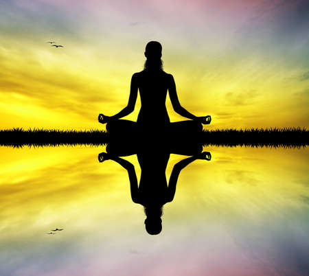 meditator: yoga silhouette at sunset Stock Photo