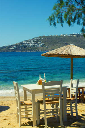 Mykonos restaurant on the beach photo