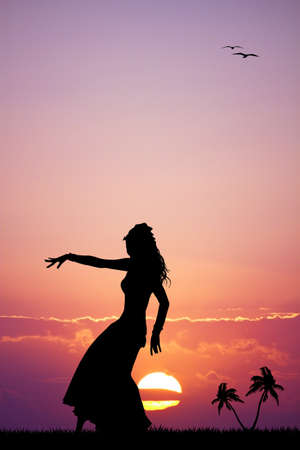 Hawaiian woman dancing at sunset photo