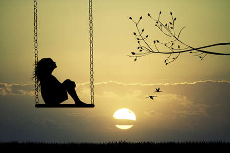 Girl on swing at sunset photo