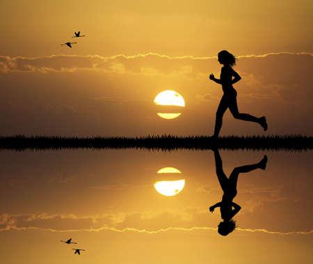Girl running at sunset photo