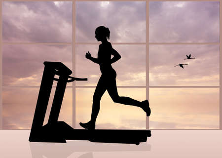 woman runs on a treadmill