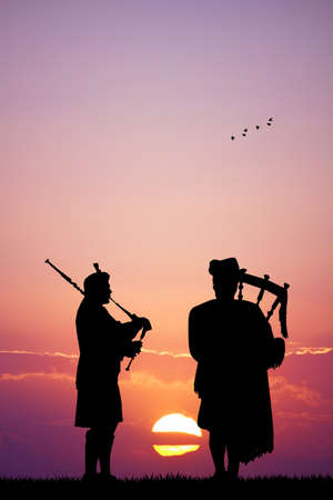 pipers: pipers silhouette at sunset Stock Photo