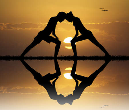 tantric: couple doing yoga at sunset