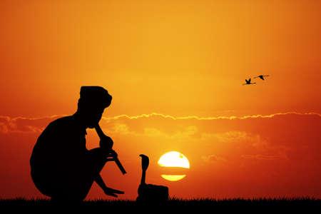 charmer: snake charmer at sunset