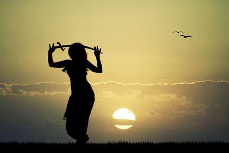 bellydance: sword bellydance at sunset Stock Photo