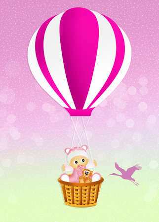 baby girl on hot air balloon photo