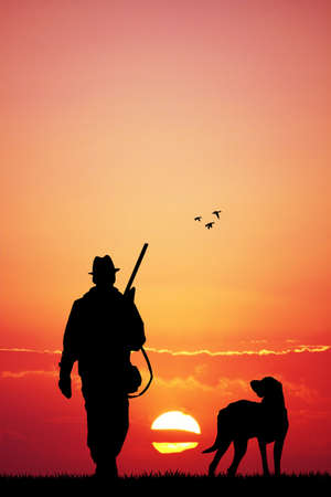 hunter with dog at sunset photo