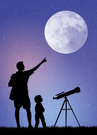 father and son looking in the telescope photo