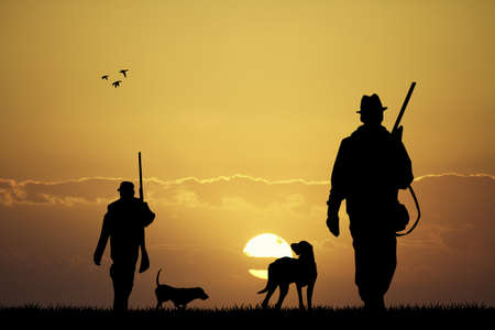 dusk: hunter at sunset Stock Photo