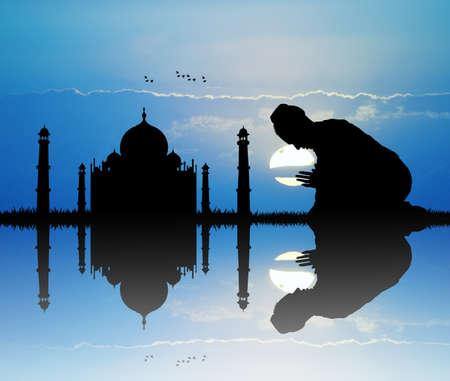 mahal: man prays in front to the Taj mahal Stock Photo