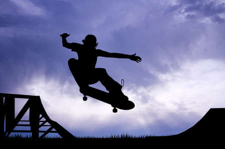 adrenaline: skateboard silhouette at sunset Stock Photo