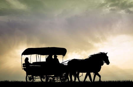 carriage western at sunset Stock Photo