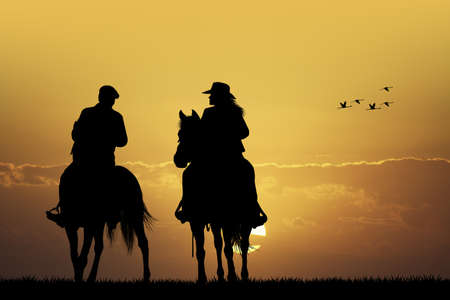 equine: couple cowboy Stock Photo