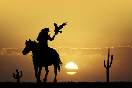 girl on horse with hawk Stock Photo