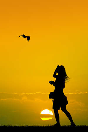 girl with hawk at sunset
