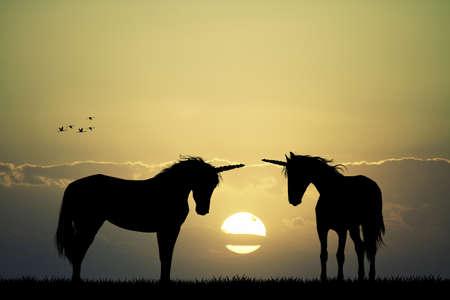 eenhoorns bij zonsondergang