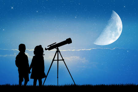 observing: look in the telescope Stock Photo