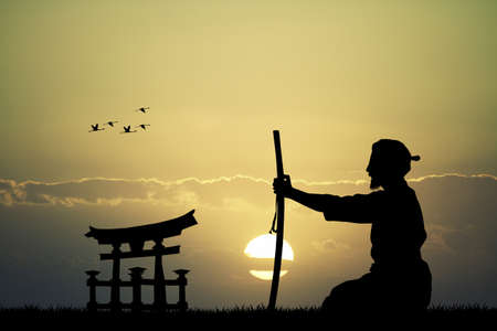Japanese man with sword at sunset
