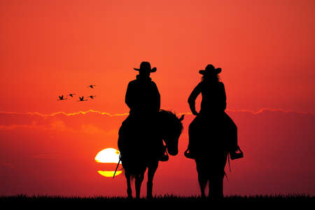 paar op paard silhouet Stockfoto