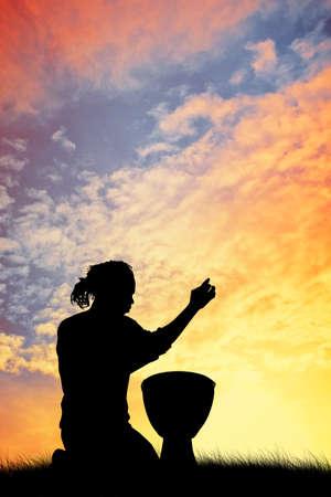 bongos: man with bongos at sunset