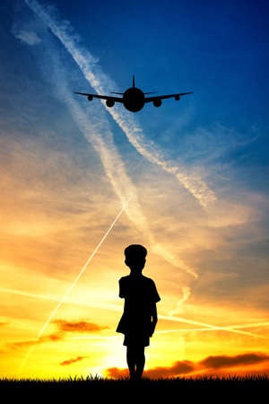 child looking the airplane