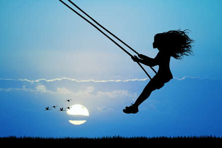happiness people silhouette on the sunset: girl on swing Stock Photo