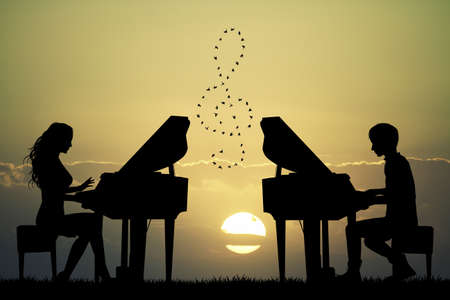 plays: plays to piano at sunset Stock Photo