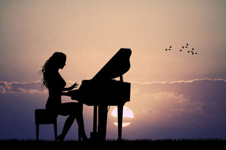 plays: woman plays the piano at sunset