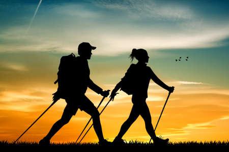 nordic walking: nordic walking at sunset Stock Photo