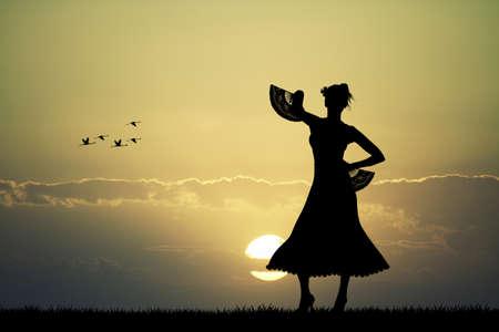 spanish fan: Spanish Flamenco dancer at sunset