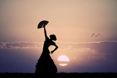 spanish woman: flamenco at sunset