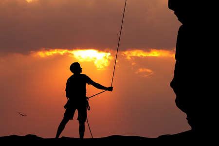 free climber: free climber at sunset