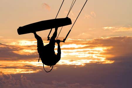 adrenalin: kite surfer at sunset