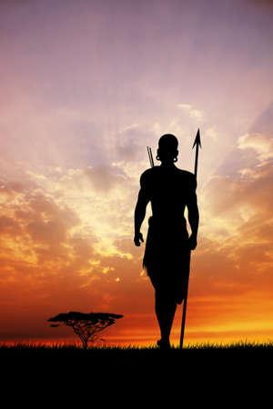 masai: Masai silhouette in African landscape