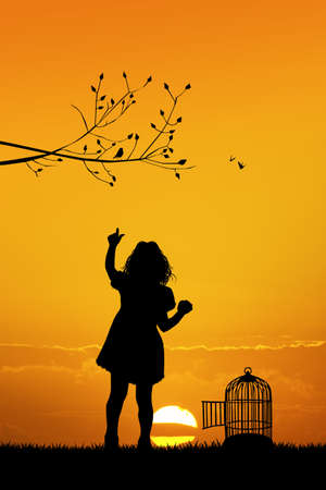 bird cage: girl with bird cage at sunset