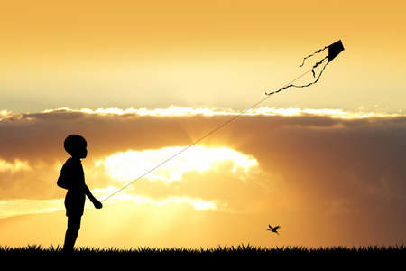 carefree: child with kite at sunset