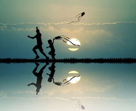 carefree: father and child with kite at sunset