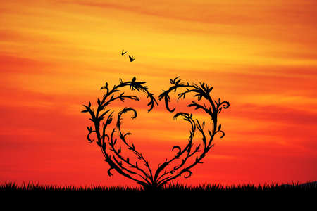 freedom couple: tree with branches in the shape of heart Stock Photo