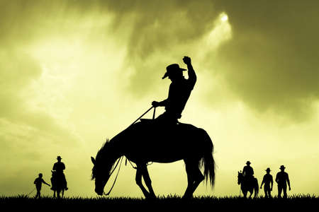 slhouette: rodeo cowboy slhouette at sunset Stock Photo