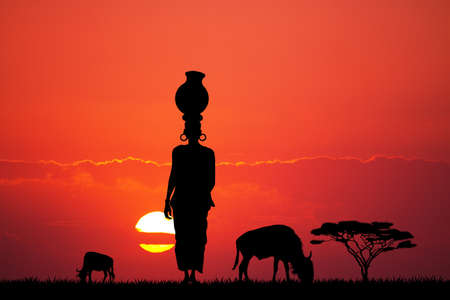 african woman: African woman silhouette at sunset Stock Photo