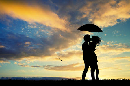 lovers kissing: couple with umbrella in the rain