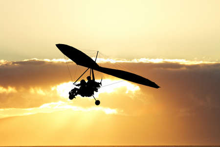 hang gliding: Hang gliding in the sky at sunset