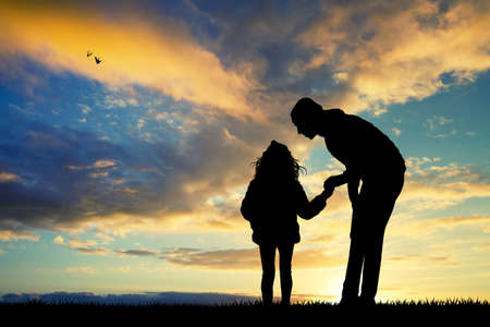 outdoor event: father and girl at sunset Stock Photo