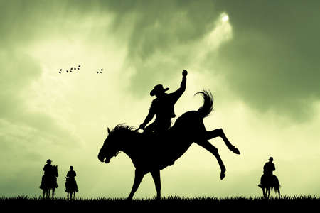 rodeo cowboy silhouette at sunset Stock Photo