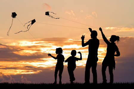 abandon: family with kite at sunset Stock Photo